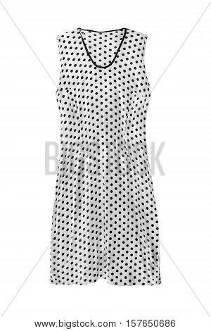 White sleeveless dress with black polka dots on white background