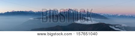 Panoramic Mountain Landscape With Amazing Clouds Floating Between Hills On The Sunrise. Himalayas Pa