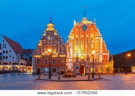 City Hall Square with House of the Blackheads and Saint Roland Statue in Old Town of Riga during evening blue hour, Latvia