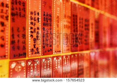 Side View On Red Plates With Inscriptions On The Wall Inside The Temple Of The Ten Thousand Buddhas