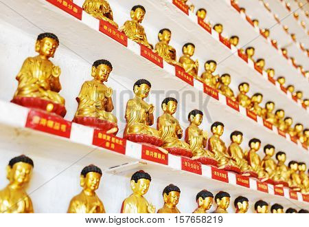 Different Small Golden Buddha Statues Inside The Temple Of The Ten Thousand Buddhas Monastery In Hon