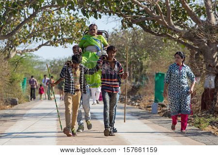 Palitana, India - March 6, 2016: Unidentified workers, carry pilgrims to the Jain temples on top of Mount Satrunjaya near Palitana, Gujarat, India.