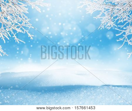 Winter christmas landscape with snowdrifts and tree branches in hoarfrost
