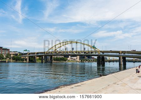 PITTSBURGH, PA - JULY 22 - Fort Duquesne bridge over the Allegheny River on July 22, 2016. The bridge is a double-decked bowstring arch bridge and located in Pittsburgh, Pennsylvania.
