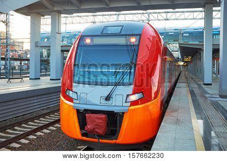 Modern high-speed train moves on a rail way.