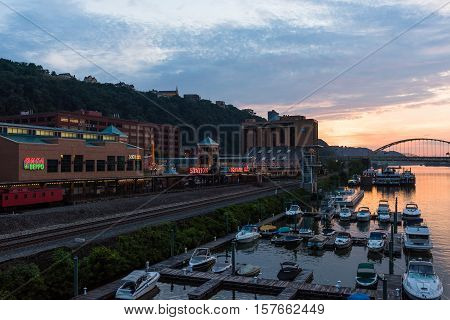 PITTSBURGH, PA - JULY 25 - A view of Station Square and the Fort Pitt Bridge in Pittsburgh, Pennsylvania at sunset on July 25, 2016