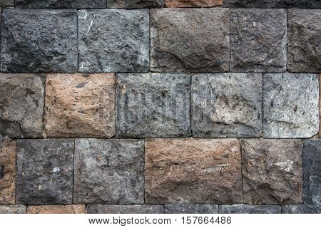 Stone wall of worked stone. Natural background from a stone.