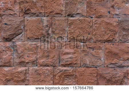 Brown stone wall, good background. Very old masonry Amen.