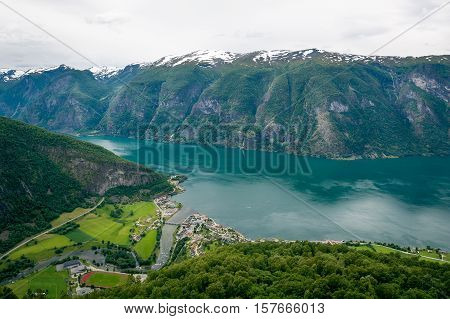 Aurlandsvangen town and fast river view from the fjord mountains. Norway fjord landscape.