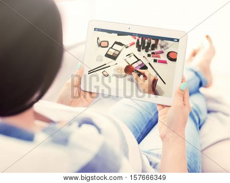 Woman watching online tutorial on tablet. Makeup and beauty blog.
