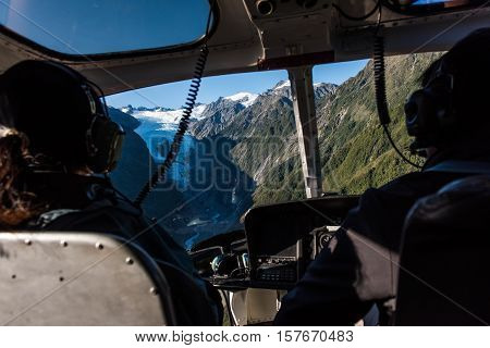 Passengers in a helicopter as it approaches the Franz Josef Glacier in New Zealand
