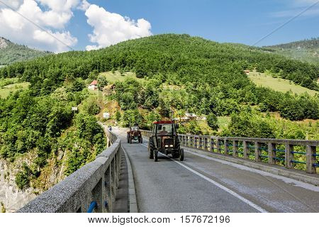 Tara River Canyon.Montenegro.04 June 2015. The tractor ride on the bridge of Dzhurdzhevich over the Tara River Canyon.