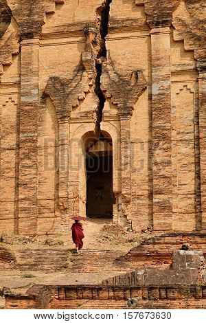 A Buddhist Monk At The Temple