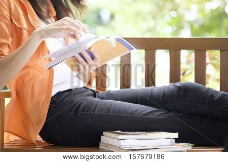 Woman reading a book. Education and relaxing concept.