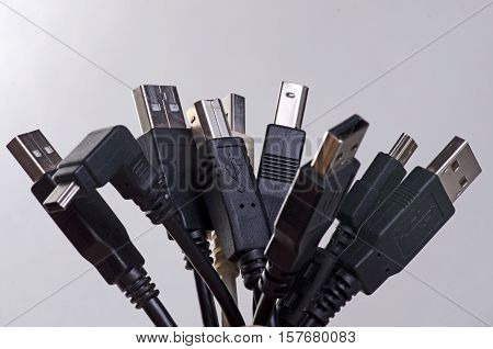 A stack of black usb plugs bonded together