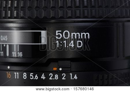 Macro photo of the lens of 50 mm side inscription