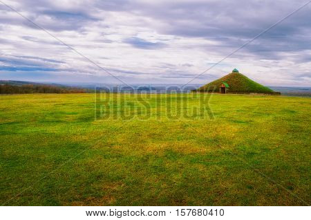 Grass field and the grave mound .