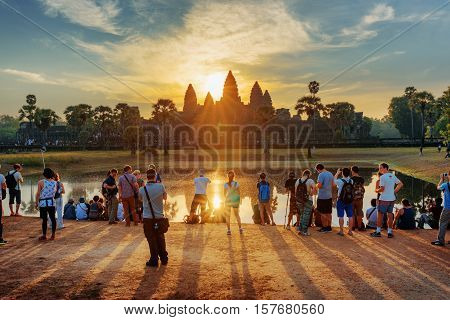 Many Tourists Taking Picture Of Angkor Wat At Sunrise