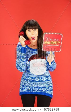 Worried Woman On Phone With Naughty Sign