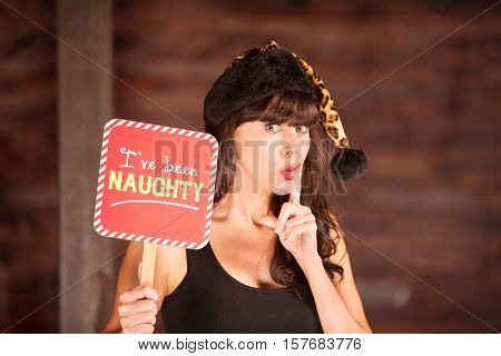 Woman In Leopard Skin Hat With Naughty Sign