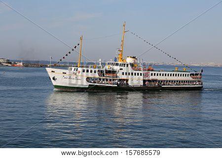 ISTANBUL TURKEY - SEPTEMBER 15 2016: Sehir Hatlari ferry carry passengers between Asian and European sides of Istanbul. Sehir Hatlari was established in 1844 and now carry 150000 passengers a day.