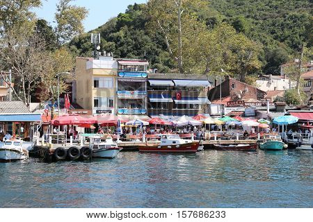 ISTANBUL TURKEY - SEPTEMBER 15 2016: People have fun in fish restaurants in Anadolukavagi coats in Istanbul. Anadolukavagi village is famous with fishing and fish restaurants.