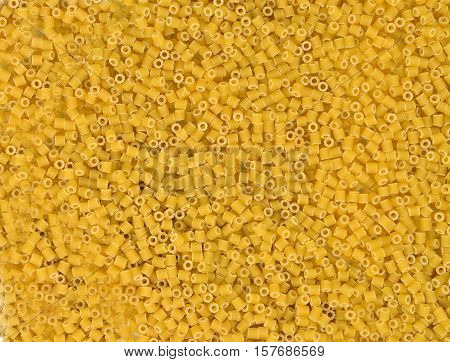 Raw yellow pasta close up. Background. Texture. Top view. Food.
