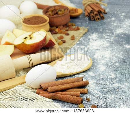 Christmas cakes with cinnamon and apples eggs and flour , natural products for holiday cooking. Close-up. Concept. Organic products. Christmas in the village. simple natural food. Home comfort. Aromas holiday./selected focus/