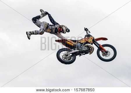 Tyumen, Russia - June 10, 2009: Red Bull X-Fighters Exhibition Tour. Freestyle Motocross. Sportsman carries out a trick