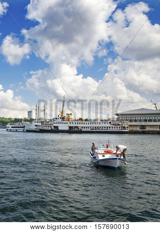 Istanbul Turkey - June 9 2013: Istanbul Ferries (called vapur in Turkish) will continue to serve as a key transport link for many Thousands of commuters tourists and vehicles per day. In the photo ferryboats are seen on Kadikoy scaffolding.