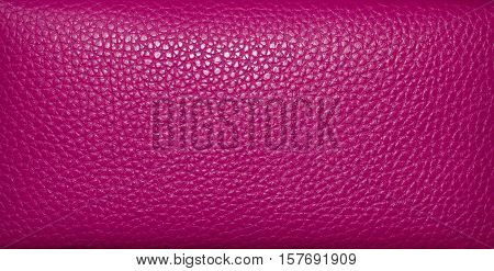 Pink leather closeup texture background. Genuine leather skin texture.
