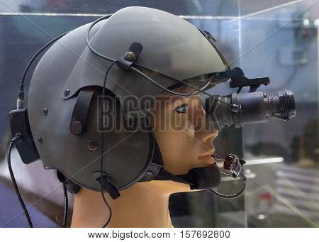 Helmet with night vision device on the demonstration mannequin. Weaponry poster