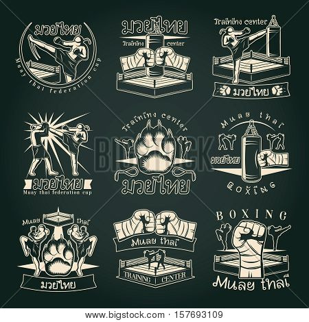 Isolated kickboxing emblems set with muay thai symbolics and fight images with captions on dark background vector illustration