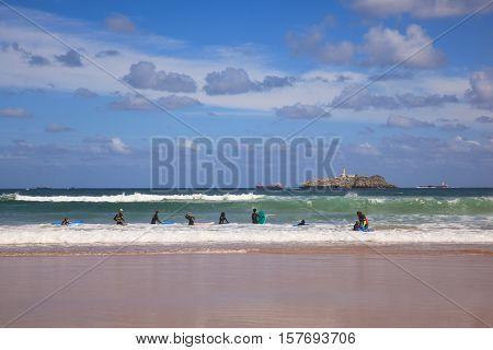 SANTANDER SPAIN - AUGUST 20: Boys teen surfing in Cantabrian sea on August 20 2016