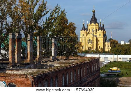 Autumn Nizhny Novgorod. The tumbledown house and Alexander Nevsky Cathedral on the Strelka