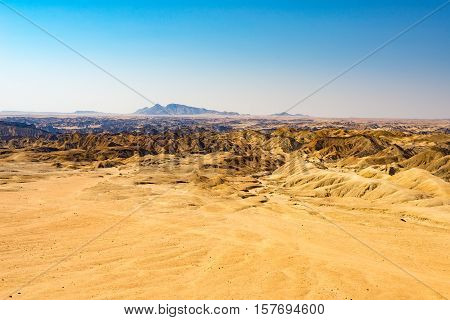 Barren valleys and canyons known as