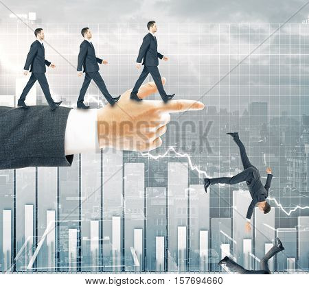Abstract image of businessmen walking and falling off pointing hand on business graph background. Risk and failure concept