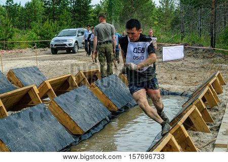 Tyumen, Russia - June 11, 2016: Race of Heroes project on the ground of the highest military and engineering school. Participants carry out anti-gravitation exercise