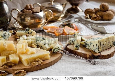 Parmesan And Other Cheeses On The Table