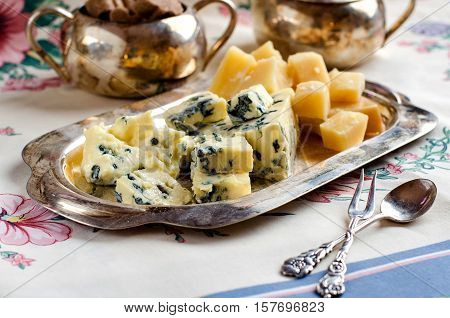 Assorted Cheeses On A Silver Platter