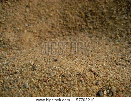 macro photo of the structure of the sand in shades of brown as the source of background in design and photo shop