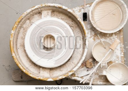 Pottery wheel and creative tools overhead view