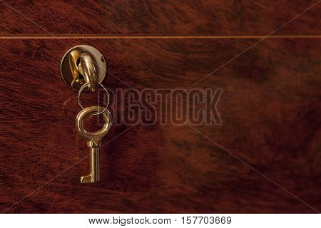 Close up of wooden box pair of brass keys inside the lock