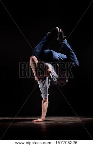 Man in motion on black background studio shot