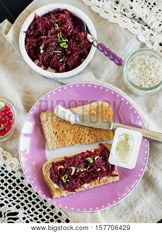 Grated beetroot with basil and goat's cheese on bread toast