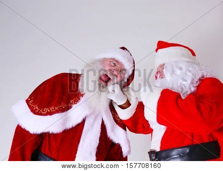 Santa Claus FIGHT! Two Santa Claus characters fight to the finish to see who is the Best Santa Claus of the season.  Santa Fight