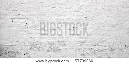White Washed  Vintage Brick Wall With  Shabby Plaster Background Texture
