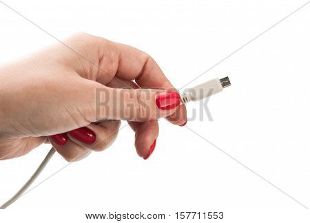 Female hand holding connector charger for mobile isolated on white background