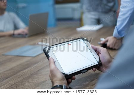 close up of businessman hands using tablet computer  on start up business meeting
