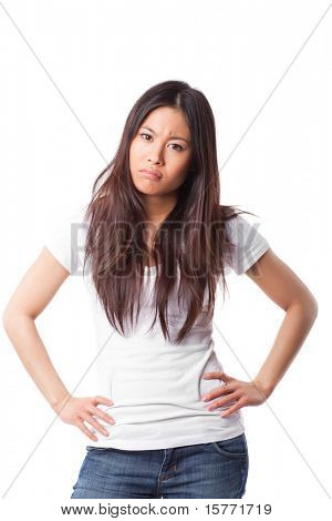 An isolated shot of an angry and pouting asian woman